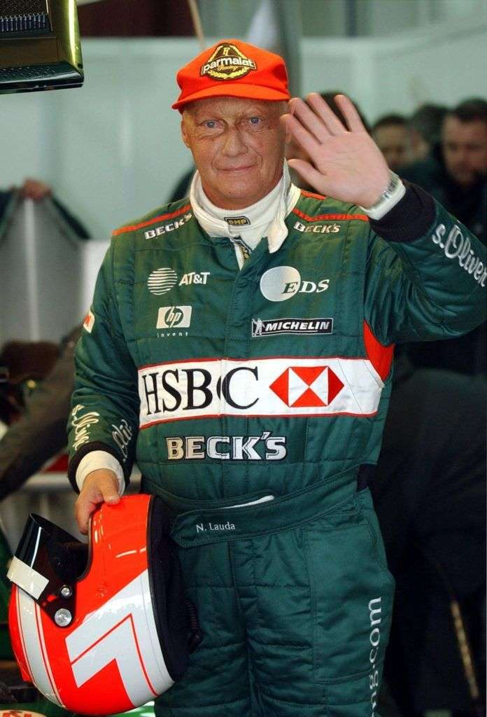 (FILES) In this file photo taken on January 13, 2002 The Ford-backed Formula One Jaguar racing team boss Niki Lauda waves after testing the last season's Jaguar R2 Formula One at Valencia's racetrack. - Legendary Formula One driver Niki Lauda has died at the age of 70, his family said in a statement released to Austrian media on May 21, 2019. (Photo by Pierre-Philippe MARCOU / AFP)
