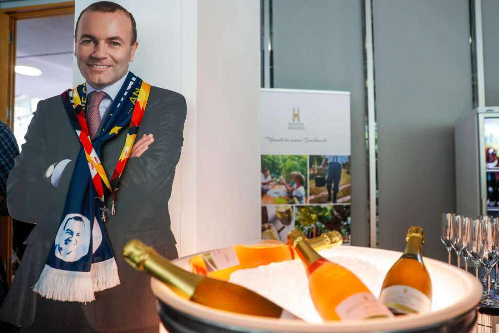 A cardboard cut-out of top candidate of the European People's Party (EPP) Manfred Weber is on display next to a bowl with bottles of sparkling during the election evening at the the CDU headquarters in Berlin on May 26, 2019 following the European parliament election. - Europeans headed to the polls in their tens of millions as 21 countries chose their champions in a battle between the nationalist right and pro-EU forces to chart a course for the union. (Photo by Odd ANDERSEN / AFP)
