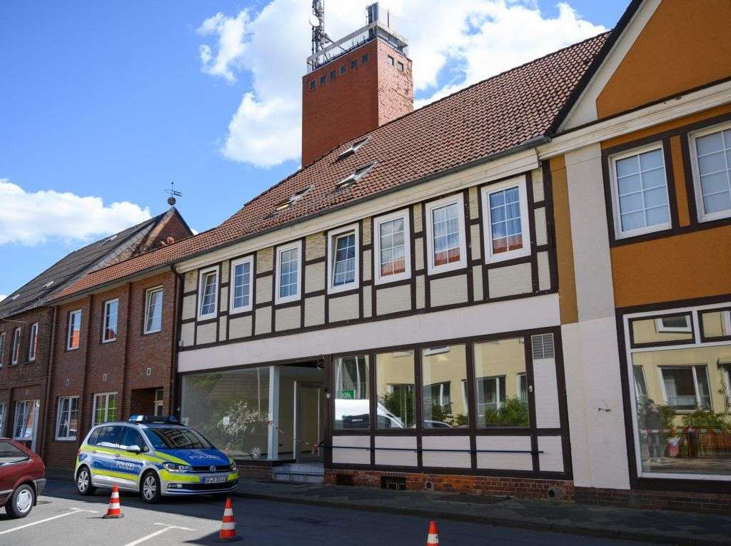 13 May 2019, Lower Saxony, Wittingen: A police car drives past a house whose entrance is secured with barrier tape. In connection with the Passau crossbow case, investigators have found two bodies in Lower Saxony. The dead women had been discovered in the apartment of one of the Passau victims in Wittingen (district of Gifhorn), a spokesman for the public prosecutor's office in Passau said on Monday. Photo: Christophe Gateau/dpa