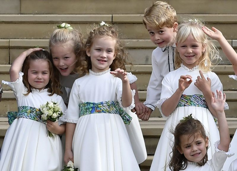 WINDSOR, ENGLAND - OCTOBER 12: Bridesmaids Princess Charlotte of Cambridge, Savannah Phillips, Maud Windsor, page boy Prince George of Cambridge, bridesmaids Isla Phillips, Theodora Williams and Mia Tindall wave as they leave after the royal wedding of Princess Eugenie of York to Jack Brooksbank at St. George's Chapel on October 12, 2018 in Windsor, England. (Photo by Toby Melville - WPA Pool/Getty Images)