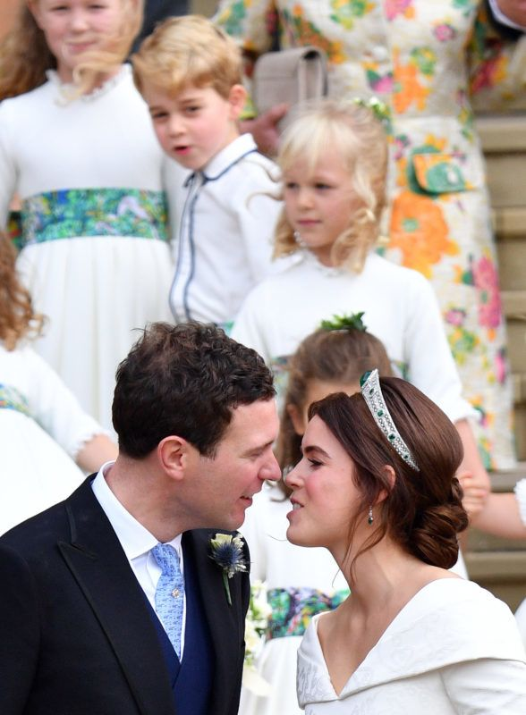 WINDSOR, UNITED KINGDOM - OCTOBER 12: (EMBARGOED FOR PUBLICATION IN UK NEWSPAPERS UNTIL 24 HOURS AFTER CREATE DATE AND TIME) Prince George of Cambridge looks on as Jack Brooksbank and Princess Eugenie kiss following their wedding ceremony at St George's Chapel on October 12, 2018 in Windsor, England. (Photo by Pool/Max Mumby/Getty Images)