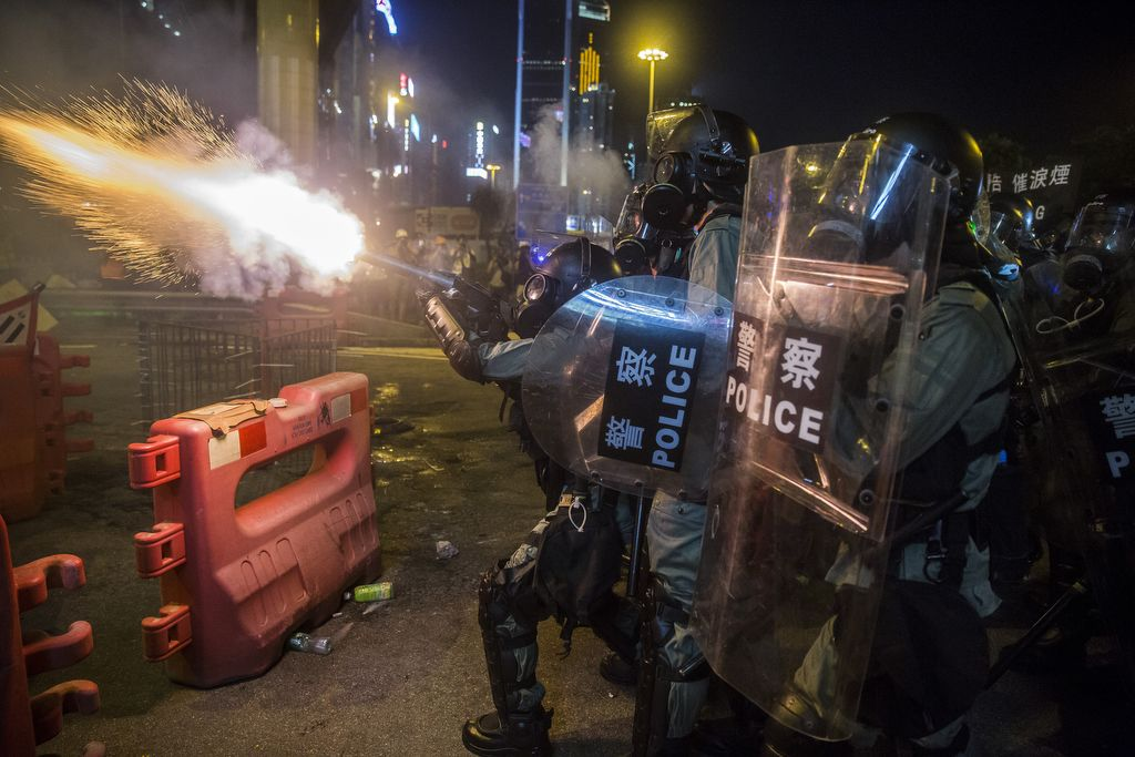 Police fire tear gas during a protest in the district of Causeway Bay in Hong Kong on August 4, 2019. - Riot police fired tear gas on August 4 at protesters on Hong Kong's main island, the second consecutive night of unrest in a territory battered by weeks of anti-government rallies. (Photo by Isaac Lawrence / AFP)