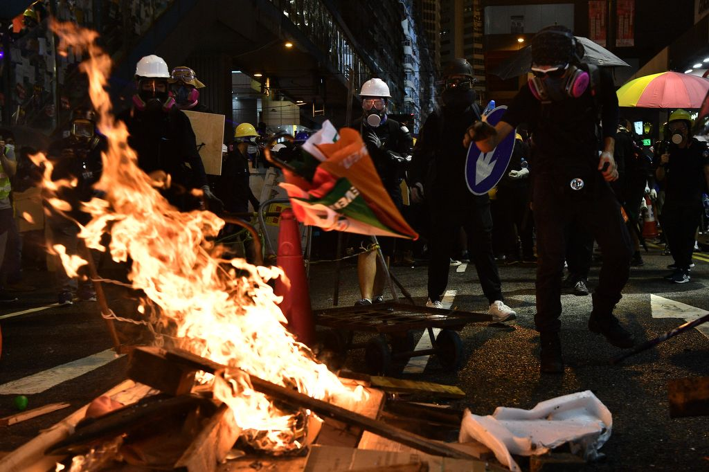 Protesters light fires as they gather in the Causeway Bay MTR station in Hong Kong on August 4, 2019. - Riot police fired tear gas on August 4 at protesters on Hong Kong's main island, the second consecutive night of unrest in a territory battered by weeks of anti-government rallies. (Photo by Anthony WALLACE / AFP)