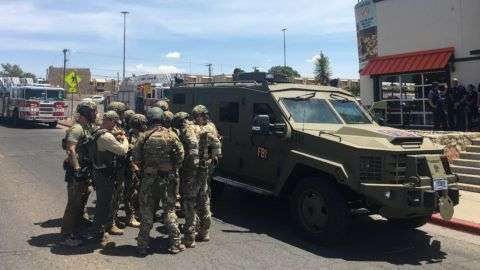 "Armed Policemen gather next to an FBI armoured vehicle next to the Cielo Vista Mall as an active shooter situation is going inside the Mall in El Paso on August 03, 2019. - Police said there may be more than one suspect involved in an active shooter situation Saturday in El Paso, Texas. City police said on Twitter they had received ""multi reports of multipe shooters."" There was no immediate word on casualties. (Photo by Joel Angel JUAREZ / AFP)"