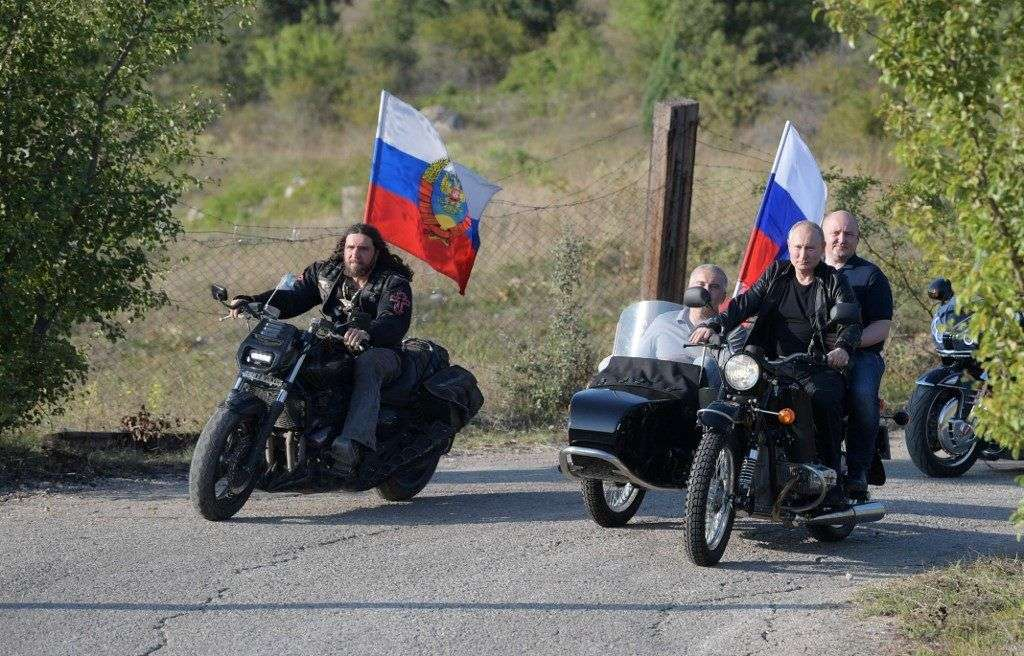 "5972543 10.08.2019 Russian President Vladimir Putin rides a bike before the Babylon's Shadow bike show in Sevastopol, Crimea, Russia. Head of motorcycle club ""Night Wolves"" Alexander Zaldostanov, is at left, Head of the Republic of Crimea Sergei Aksenov, second left, and Acting Governor of Sevastopol Mikhail Razvozhaev, is at right. Alexei Druzhinin / Sputnik"